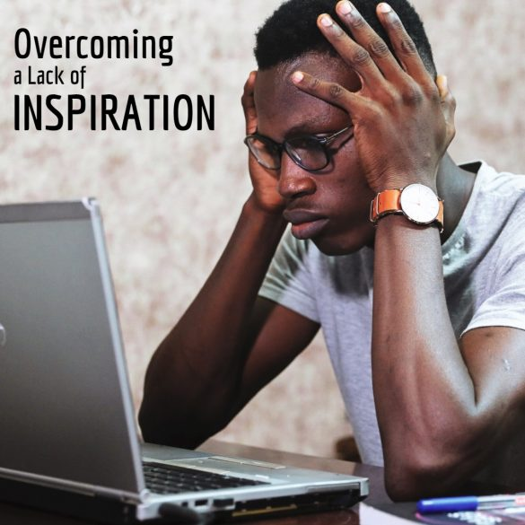 Man using a laptop with overcoming a lack of inspiration text